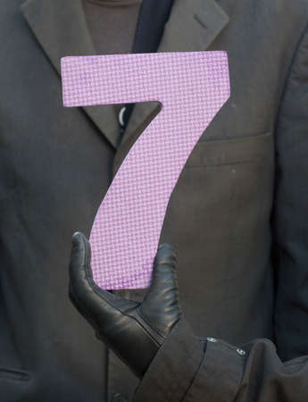 symbol of the number seven or seventh, an arabic numeral