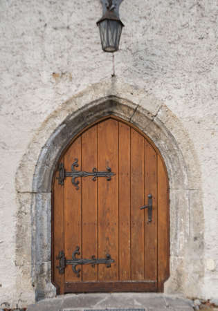 Vintage and wooden door, the entrance to an old building Stockfoto