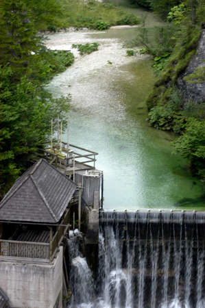 small hydroelectric power station in europe, with water basin nearby 版權商用圖片