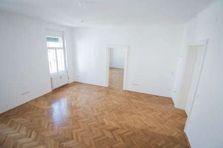 an empty living room, lounge room or sitting room in an apartment