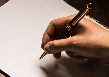 writing pen on a blank sheet, starting to write or writer's block