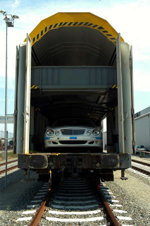 the transport of cars by rail with the cargo train
