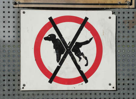 a no dogs allowed sign, ban of dogs in a specific area