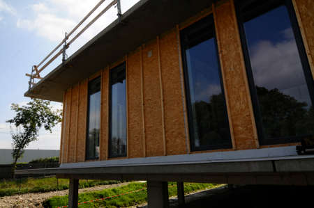an office building in timber construction, building architecture with wood