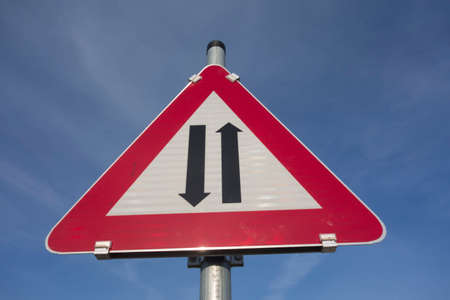 attention two way traffic or oncoming traffic road sign, red triangle as warning notice