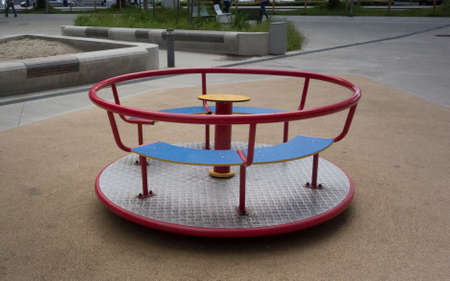 children carousel on a playground, leisure and outdoor activity for kids