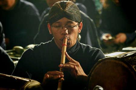 javanese: javanese flute man playing javanese bamboo flute