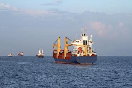 Cargo ship sailing the sea  Stock Photo