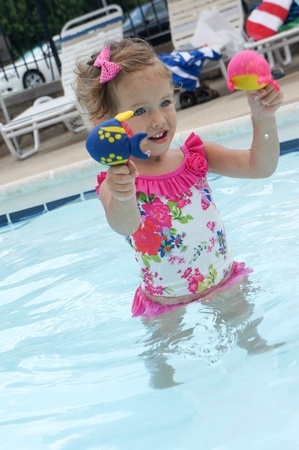 man made structure: Cute baby girl is having fun in the pool Stock Photo