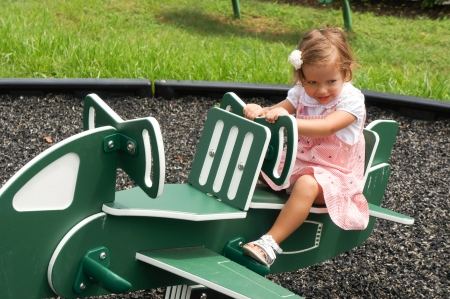 cute girl on playground Stock Photo - 21399198