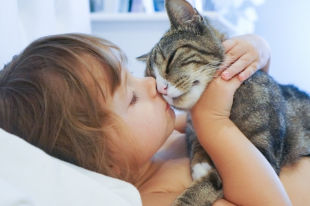 love image: baby girl and the kitty Stock Photo