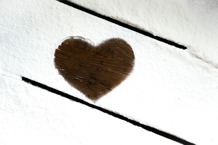 heart mark on wooden table  photo