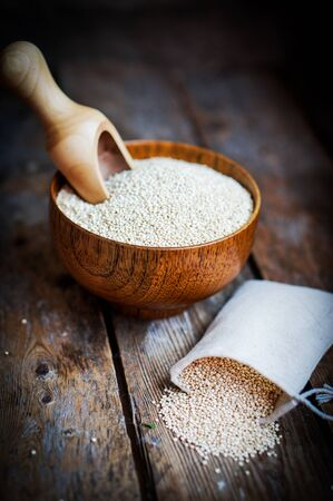 White quinoa on rustic wooden background Zdjęcie Seryjne - 57557462