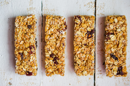 Granola bar on wooden background photo