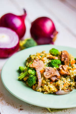 Brown rice with vegetables photo