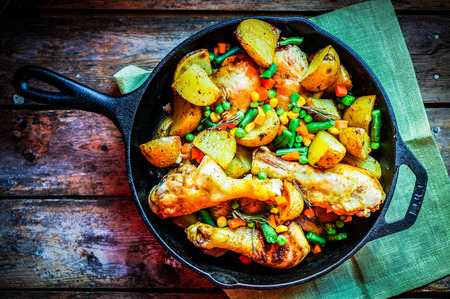 chicken with baked potatoes and vegetables