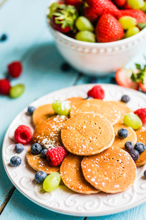 Pancakes with berries photo