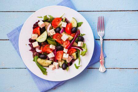 Greek salad on wooden background Zdjęcie Seryjne - 57469747