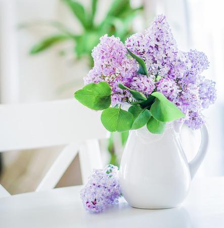 lilacs inside a white jar  Banco de Imagens