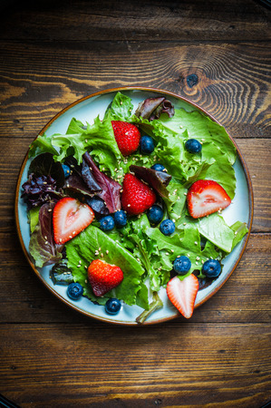 salad with greens and berries photo