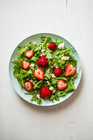 raw vegetables: salad with strawberries