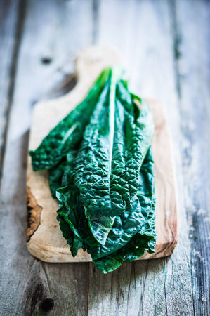 eating salad: kale on wooden table