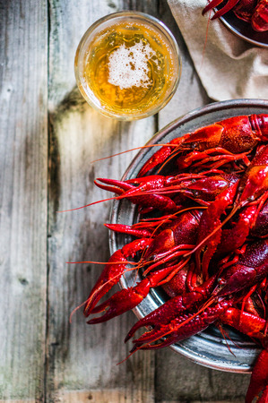 crawfish with beer on wooden table