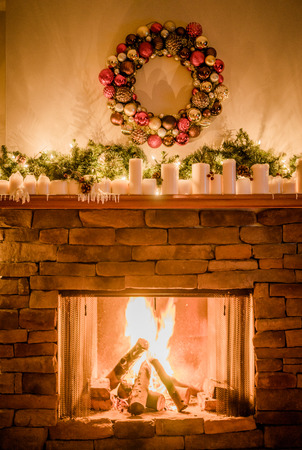 stone fireplace: Decorated fireplace for christmas