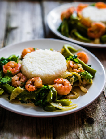 Shrimps with rice and vegetables photo