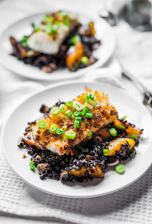 Grilled fish with black rice photo