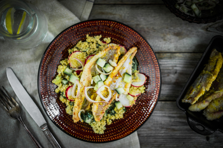 Grilled catfish with quinoa and radish salad photo