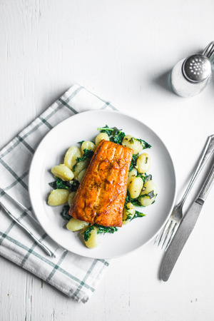 Grilled salmon with gnocchi and greens Banco de Imagens
