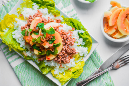 Meat with rice and papaya photo