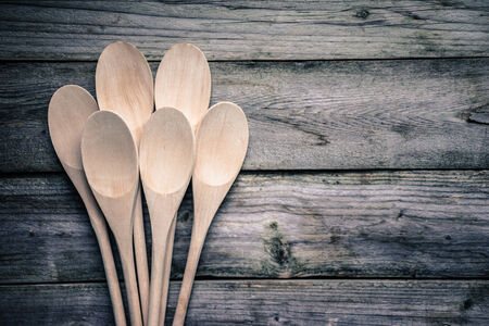 Wooden spoons on rustic background 免版税图像
