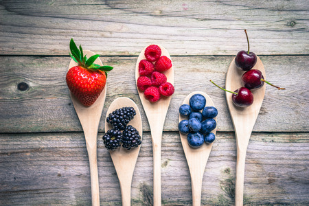 Berries on wooden rustic background photo