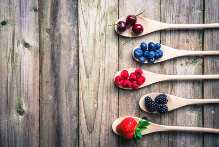 Berries on wooden rustic background