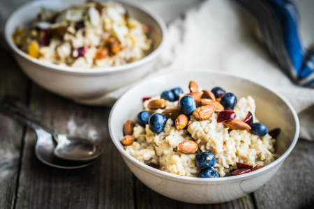 vegetarian food: Oatmeal with berries and nuts Stock Photo
