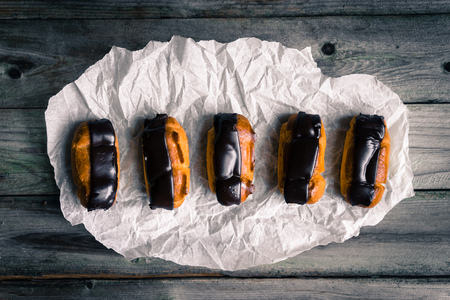 Eclairs on rustic background photo