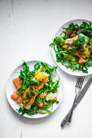 Grilled fish with arugula salad photo