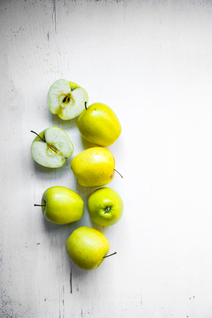 Bright apples on white wooden background photo