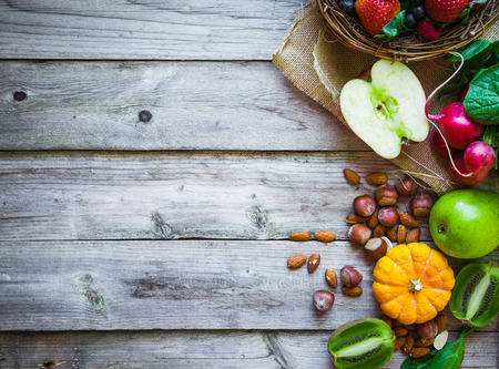 eating fruit: Fruits and vegetables on rustic background