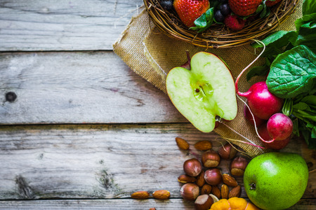 raw vegetables: Fruits and vegetables on rustic background