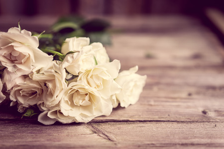 rustic: Roses in a vase Stock Photo
