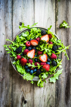 Green salad with arugula and berries