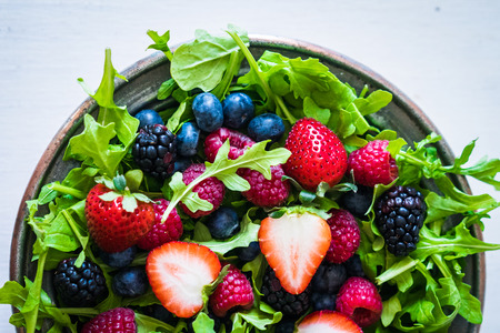 Green salad with arugula and berries Banco de Imagens - 39509742