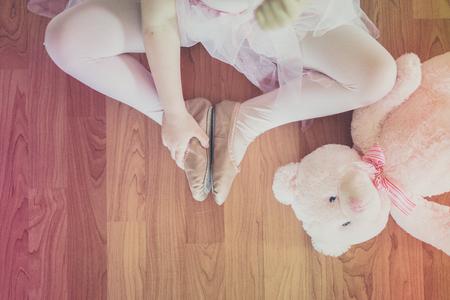 Cute girl with her teddy bear photo