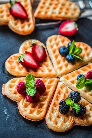 Heart waffles with berries 스톡 콘텐츠