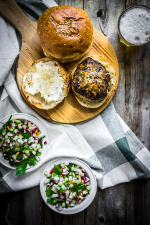 Healthy homemade burger on wooden background Standard-Bild