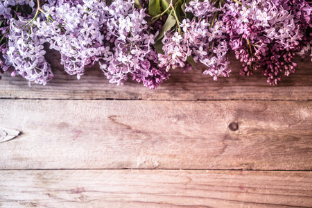backgorund: Lilacs on wooden backgorund Stock Photo