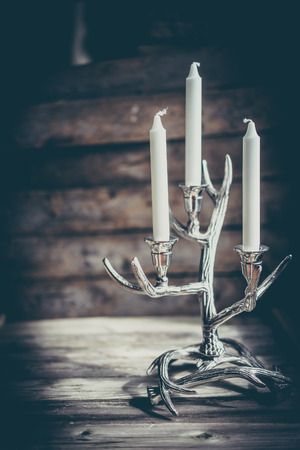 candle holder: Rustic candle holder on wooden background Stock Photo